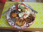 BBQ chicken with mango chipolte sauce, potatoe salad and garlicbread