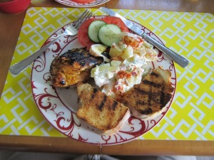BBQ chicken with mango chipolte sauce, potatoe salad and garlic bread