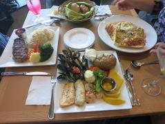 steak, seafood pasta and seafood platter